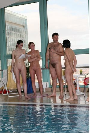 nudist family swimming